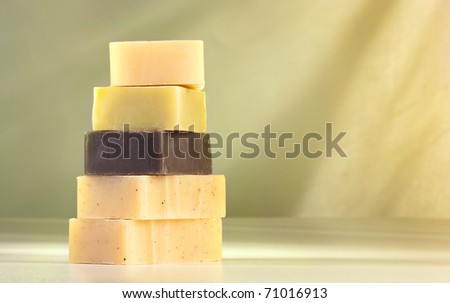 Handmade natural soaps arranged in a pile
