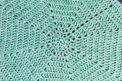 handmade octogon multicolor crochet background in green and white with double crochet stitches