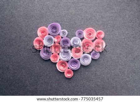 Handmade paper flowers heart on dark felt background. Beautiful Pink, lilac, purple paper roses in the form of heart. Greeting card. Love romance concept