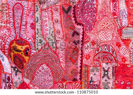 Handmade patchwork quilt from India as background