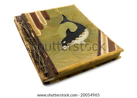Handmade photo album with dolphin on the cover. Isolated on white background