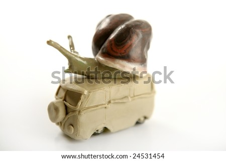 Handmade plasticine van with snail over, isolated on white
