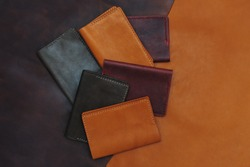 Handmade products made of genuine yellow and red leather. Leather passport cover, leather wallet. Leather goods for men. The view from the top