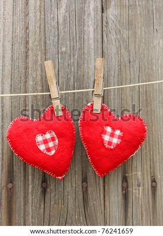 Handmade red hearts of felt on a string