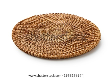 Handmade round woven placemat placed on a white background. Stock photo ©