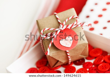 Handmade small gift box with heart tag and twine cords