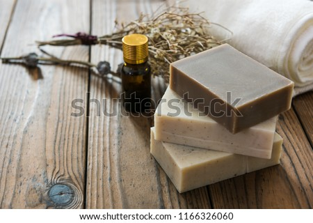 Handmade soap, spa, beauty skincare concept, handmade soap and dried flowers on old table