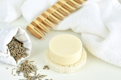 Handmade solid shampoo bar with lavender on luffa, zero waste product, natural hair care