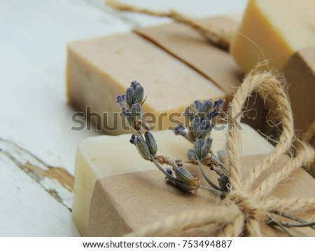 Handmade spa lavender soap on old vintage wooden background. Soap making. Soap bars. Spa, skin care.