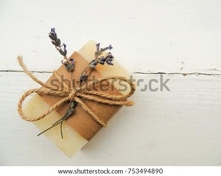 Handmade spa lavender soap on old vintage wooden background. Soap making. Soap bars. Spa, skin care.
