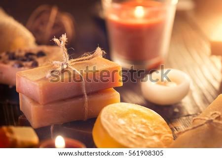 Handmade Spa Soap closeup. Organic Soap making. Various soap bars and candles closeup. Spa treatments.