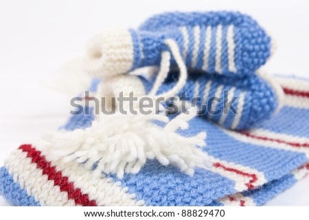 Handmade sweet baby booties isolated on a white background