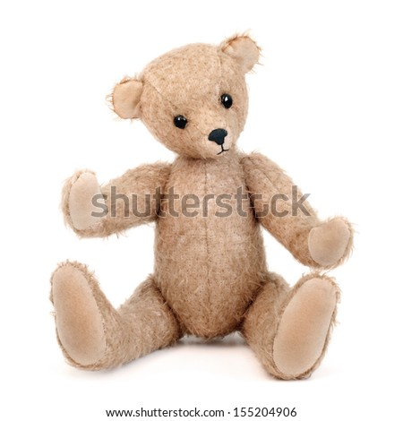 Handmade teddy bear isolated on white background