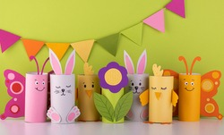handmade toilet paper roll toys for children, bunnies butterflies birds. needlework is a craft made of paper. Recycling