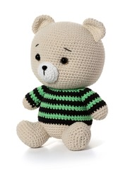 Handmade toy beige bear on a white background. Knitted toy. Full depth of field. With clipping path.