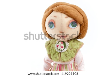 handmade toy cute litlle girl with big eyes isolated