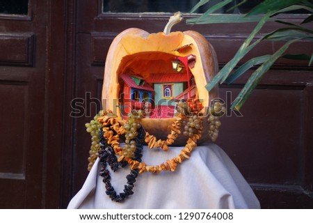 handmade toys. handmade toy house in a pumpkin #1290764008