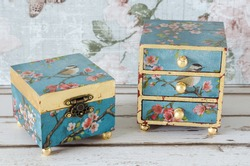 Handmade trinket box and mini chest of drawers on a shabby chic background