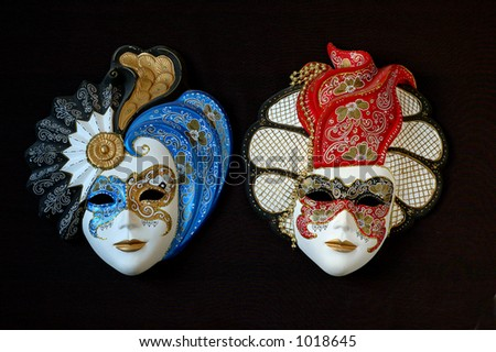 handmade Venetian masks. The colours of the masks are typical of 18th century theatre in Italy.