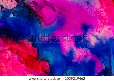 Handmade watercolor with blue, purple and red. Useable as a background or texture.