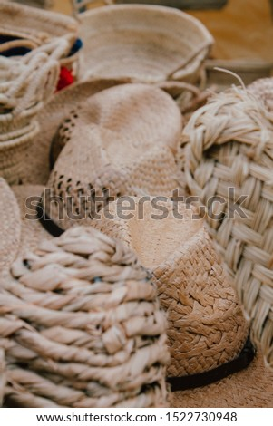 Handmade wicker baskets at a street fair. The concept of craft products, selling unique things, traditional culture. Ecological baskets not to consume plastic and go shopping
