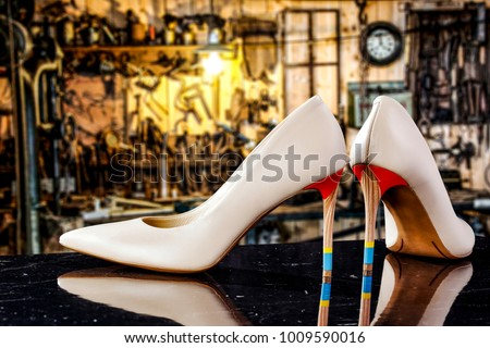 Handmade woman shoes and blurred background of workspace. Free space for your decoration.