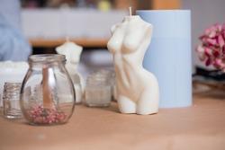 Handmade woman torso wax candle with aromatic oils.