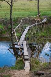 Handmade wooden bridge above river