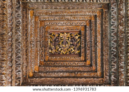 Handmade wooden ceiling roof in balinese style with flowers and birds ornament. Seamless ornament #1396931783