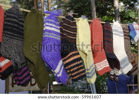 Handmade wool socks hanging on a clothesline
