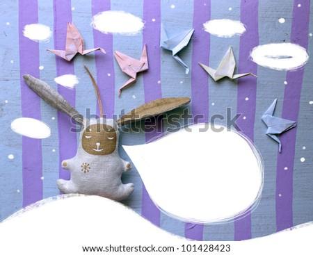 Handmaid toys.Postcard with bunny