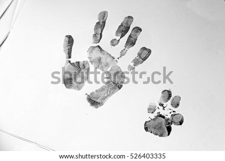 Handprint and dog painted on paper, animal adoption