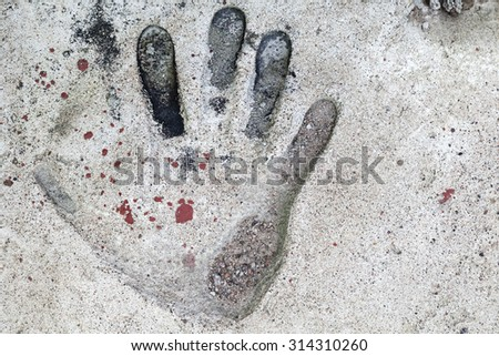 Handprint in the old gray concrete slab