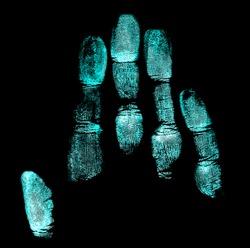 Handprint on black background. Handprint with ultraviolet lamp.
