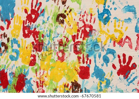Handprints in different colors in a mural. Background picture.