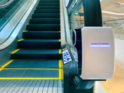 handrail ultraviolet sterilizer for hygiene of escalator handrail at shopping mall as pandemic influenza precautions procedure during Covid-19 situation