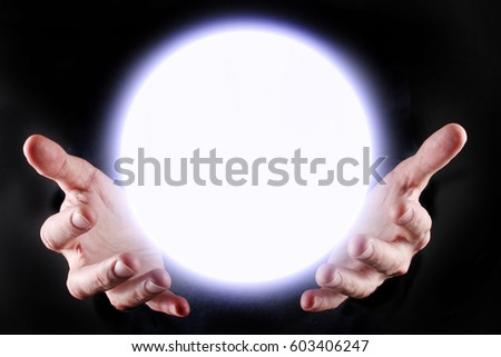 Hands and a glowing sphere between them  #603406247