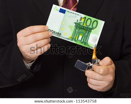 Hands and burnning money - business concept