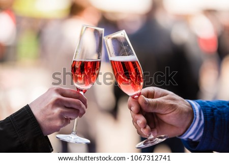 Hands and champagne glasses with prosecco #1067312741