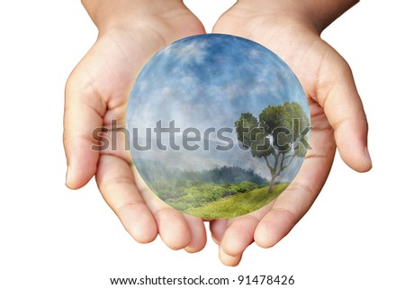 Hands and Earth. Concept of saving planet. Symbol of environmental protection and conservation.