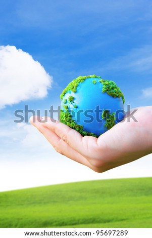 Hands and Earth. Concept Save green planet.