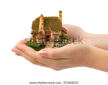 Hands and house isolated on white background