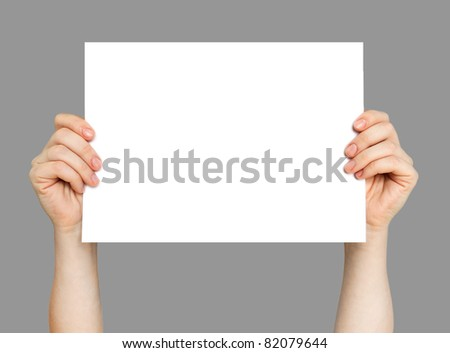 Hands and paper isolated on grey background