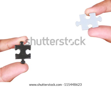 Hands and puzzle, isolated on white background - stock photo