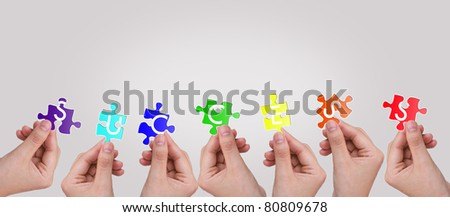 "Hands and puzzle with word "" Success """