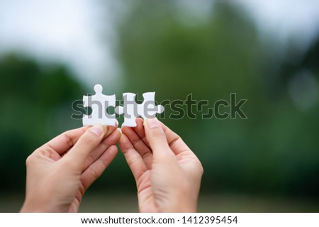 Hands and puzzles, important pieces of teamwork Teamwork concept #1412395454