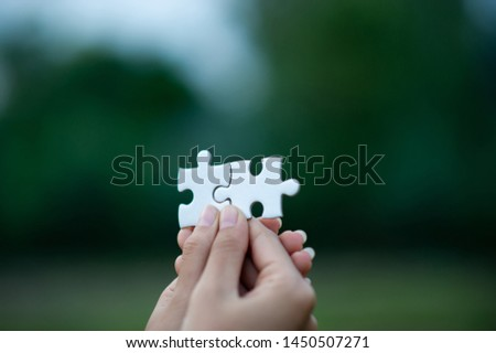 Hands and puzzles, important pieces of teamwork Teamwork concept #1450507271