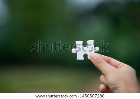 Hands and puzzles, important pieces of teamwork Teamwork concept