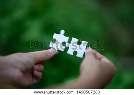 Hands and puzzles, important pieces of teamwork Teamwork concept #1450507283
