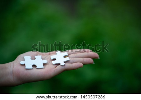 Hands and puzzles, important pieces of teamwork Teamwork concept #1450507286